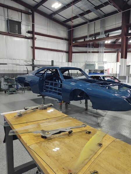 dc-93 putting glass back in for next petty blue coat of paint.JPG