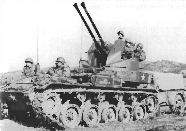 m19-twin-40mm-gun-motor-carriage-with-standard-m28-1-ton-ammunition-trailer.jpg
