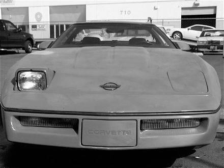 vemp_0407_01_z+c4_chevy_corvette+open_headlights.jpg
